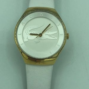 Lactose white watch with gold trim in good cond.